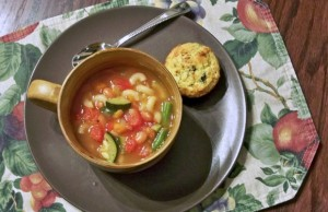 bowl of delicious minestrone soup on plate with spoon and crackers, soup recipes, healthy recipes