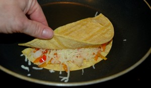 shrimp quesadilla in skillet with peppers and cheese, cinco de mayo, mexican recipes