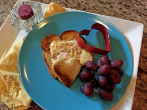 mothers day breakfast recipe, heart shaped egg in toast, breakfast in bed, egg, toast, grapes, candle