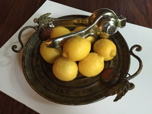 lemons with lemon press on platter, lemon recipes, healthy recipes