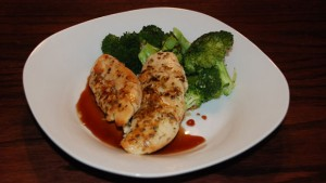 parmesan chicken with balsamic vinegar reduction, served with broccoli,