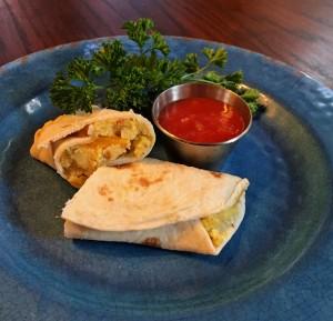 breakfast burrito on plate with salsa and parsley, breakfast recipe, healthy breakfast