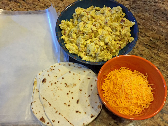 tortillas, scrambled eggs, cheddar cheese, wax paper, healthy breakfast burrito