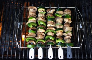 cave tools kabob set on gas grill, chicken kebabs