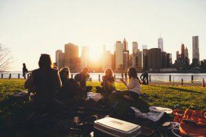 Friends Sitting on Grass in Park - Unsplash Ben Duchac