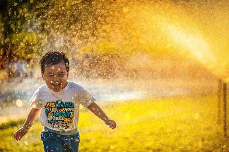 Boy celebrates, smiles, laughs